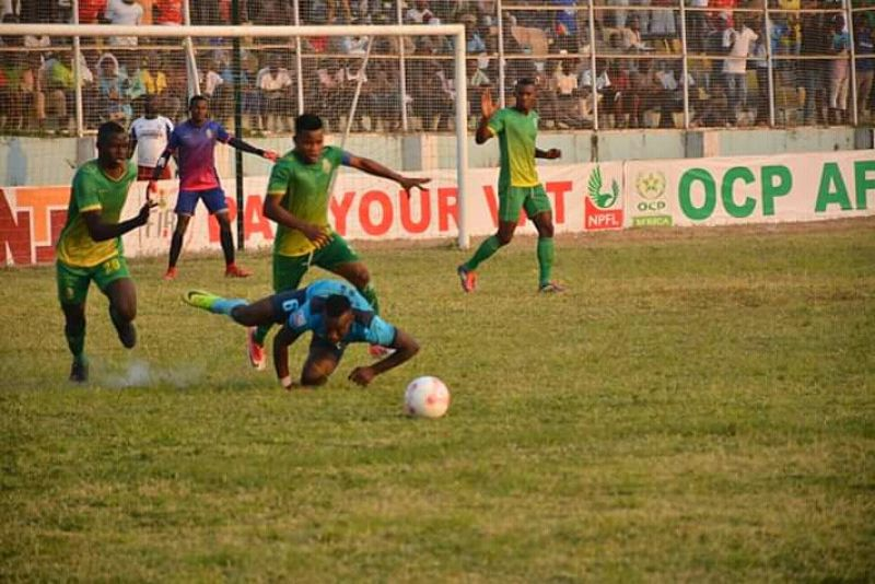 •Photo shows action from a Bendel Insurance match